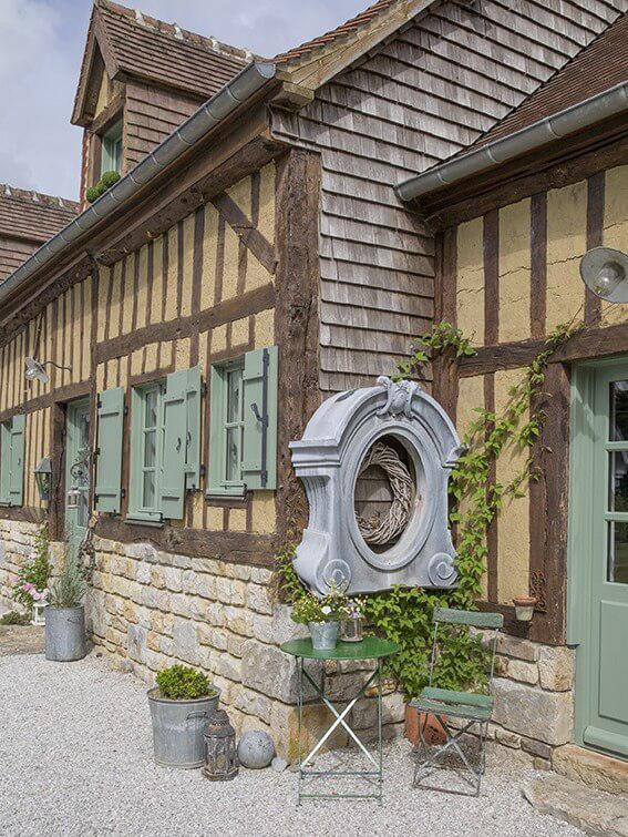 Oeil-de-boeuf maison à colombages en Normandie